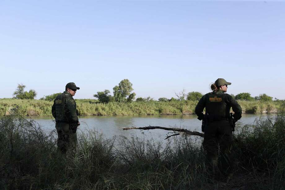 Supervisory U.S Border Patrol Agent Rene Quintanilla, left, and Agent Amber Peterson check out a known smuggling point along the Rio Grande near Pe–itas, Texas, Thursday, July 19, 2018. The U.S. Customs and Border Protection, the largest law enforcement 