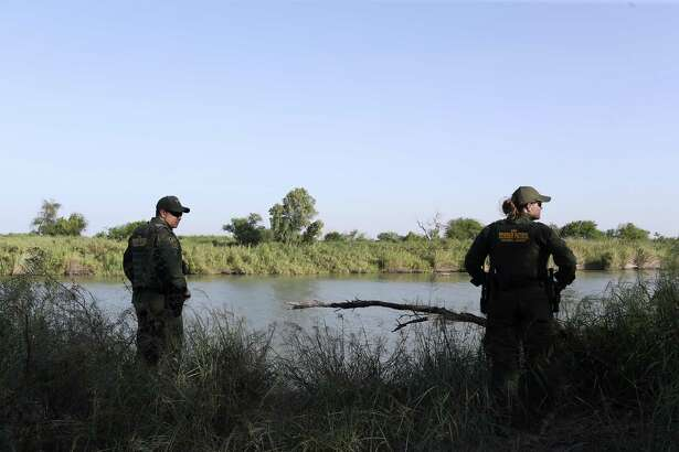 Supervisory U.S Border Patrol Agent Rene Quintanilla, left, and Agent Amber Peterson check out a known smuggling point along the Rio Grande near Pe?-itas, Texas, Thursday, July 19, 2018. Surveillance alerted them to possible smugglers on the Mexican side of the river but it was unknown as to where they were attempting to cross humans or drugs.