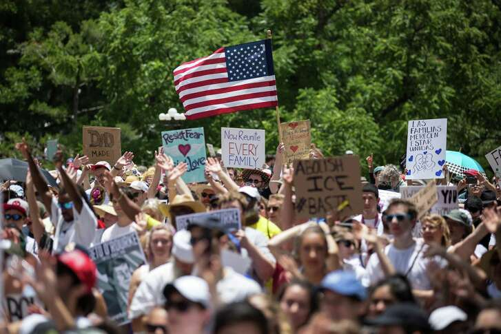 AUSTIN, TX - Demonstrators rally against the Trump administration's immigration policies outside of the Texas Capitol in Austin, Texas, on June 30, 2018.