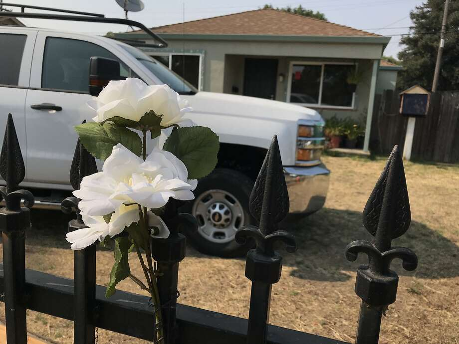 The makeshift memorial in front of the house on Georgia St. in Vallejo, Ca. where three people were killed in a house fire over the weekend. Authorities believe the mother, 47-year-old Mau Dao, set herself on fire at the Georgia Street residence, resulting in a blaze that killed her 14-year-old daughters, Trinh and Tram Tran. Photo: Chris Preovolos