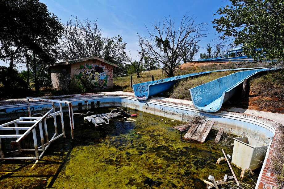 Hero's Water World photographed Aug. 9, 2018. The water park was built in 1980 and included a go-kart track and mini-golf. It changed ownership multiple times before being closed in 2003. The facility has been vandalized, covered in graffiti and is now home to many west Texas wild animals. Some artifacts from the old park remain scattered throughout the buildings, including lockers, admission tickets, checkbooks, pool chairs and flotation devices. The park was recently purchased by a buyer who plans to build an event center and water park, using much of the original park as a foundation, according to realtor John Herriage of Copper Key Realty. James Durbin/Reporter-Telegram Photo: James Durbin