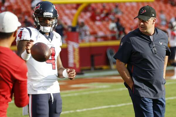 Houston Texans head coach Bill O'Brien talks to quarterback Deshaun Watson. (4) before an NFL football game against the Kansas City Chiefs at Arrowhead Stadium on Thursday, Aug. 9, 2018, in Kansas City.
