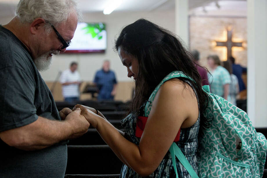 Tears stream down the face of Danielle Kelley as Stephen Willeford, who shot her husband and ended Kelley's massacre, prays with her after the first service Kelley attended at First Baptist Church of Sutherland Springs, since the Nov. 5 shooting, on June 17, 2018. (Lisa Krantz | San Antonio Express-News) / San Antonio Express-News
