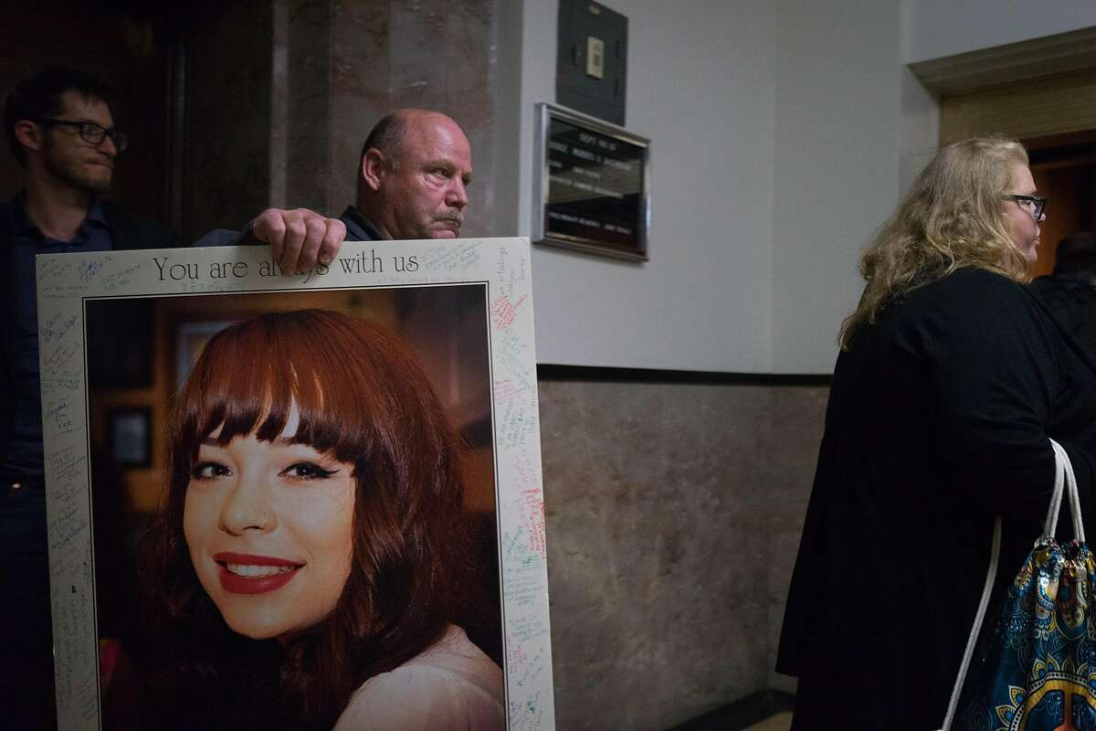A relative carries a photo of Michela Gregory, a 20-year-old Ghost Ship fire victim, at the sentencing hearing of defendants, Derick Almena and Max Harris, at the Rene C. Davidson Courthouse in Oakland, Calif. on Thursday, August 9, 2018.