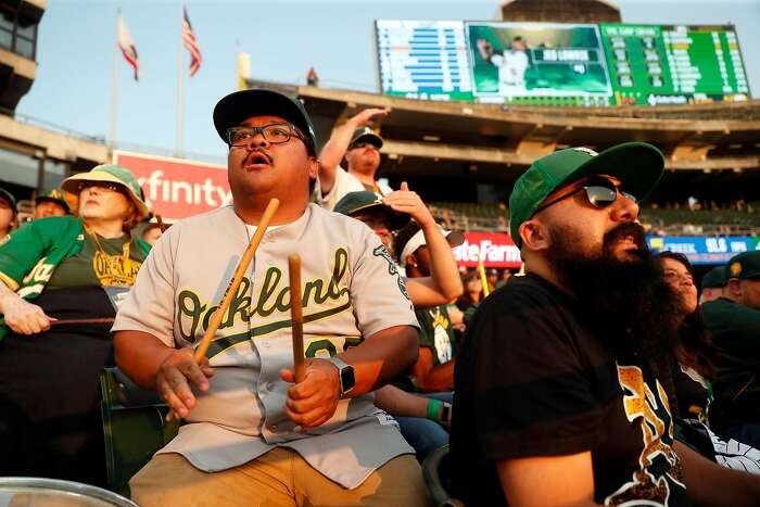 Oakland Athletics' fans Bryanne Aler-Ninges of Pittsburg watches the A's play the Los Angeles Dodgers from right field bleachers at Oakland Coliseum in Oakland, Calif. on Wednesday, August 8, 2018.