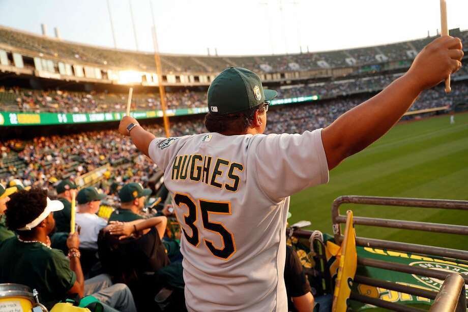 Oakland Athletics' fans Bryanne Aler-Ninges of Pittsburg watches the A's play the Los Angeles Dodgers from right field bleachers at Oakland Coliseum in Oakland, Calif. on Wednesday, August 8, 2018. Photo: Scott Strazzante / The Chronicle