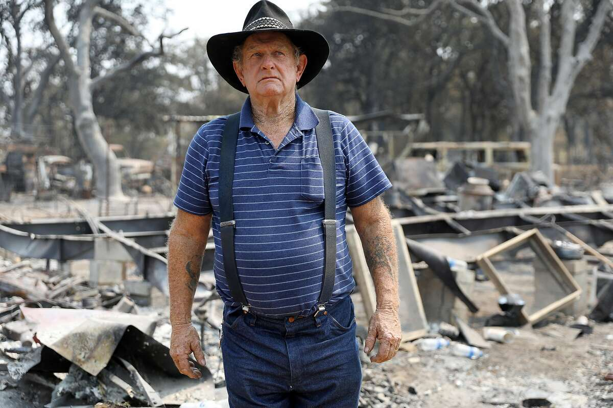 Ed Bledsoe visits the wreckage of his home near Redding on Wednesday, August 8, 2018. Bledsoe lost his wife, Melody, and great-grandchildren, James Roberts Jr., 5, and Emily Roberts, 4, in the Carr Fire.