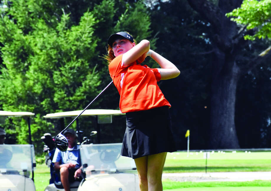 Edwardsville's Riley Lewis watches her tee shot on Hole No. 5 at Senica's Deer Creek Golf Club in Oglesby on Thursday. The Tigers opened their season in the Prep Tour Showcase. Photo: Matthew Kamp