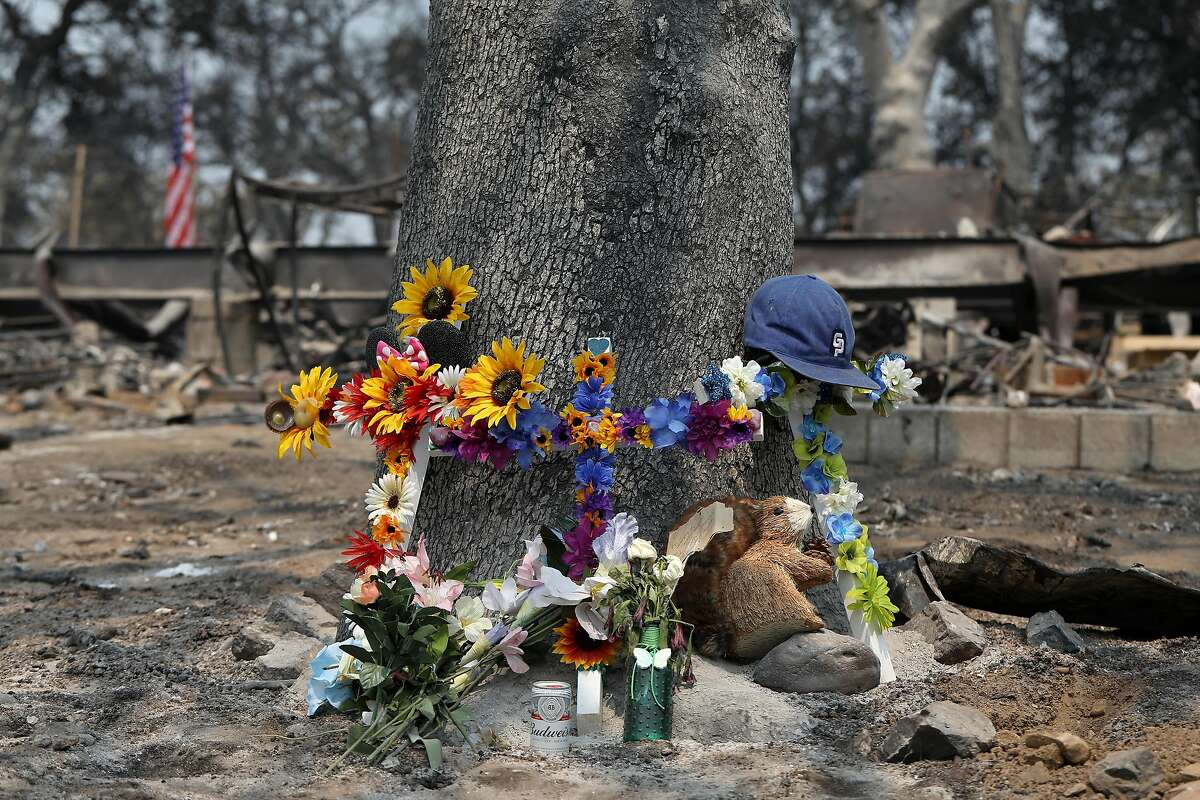 A memorial outside the home near Redding where Melody Bledsoe, James Roberts Jr., 5, and Emily Roberts, 4, were killed in the Carr Fire.
