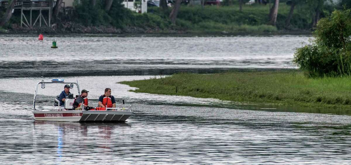 Members of the Waterford Rescue Squad move their boat round Pebbles Island as the search continues for a missing 14 year old male on the Thursday Aug. 9, 2018 in Waterford, N.Y.(Skip Dickstein