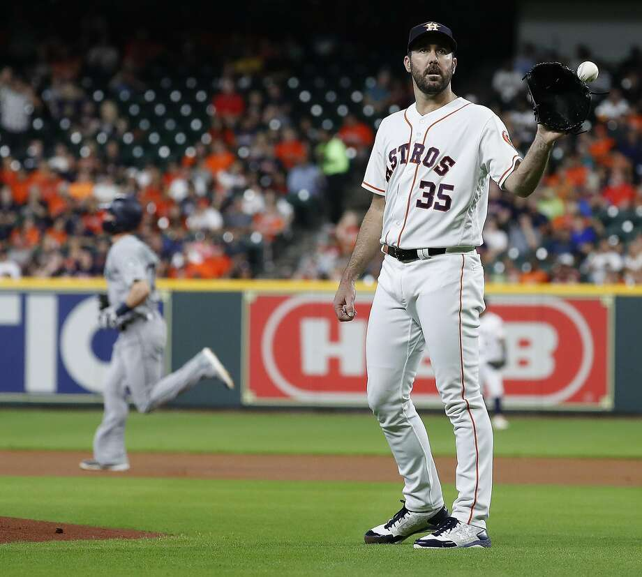 Astros starting pitcher Justin Verlander (35) reacts after giving up a home run to Seattle Mariners Mitch Haniger during the first inning of an MLB game at Minute Maid Park, Thursday, August 9, 2018, in Houston. Photo: Karen Warren / Houston Chronicle