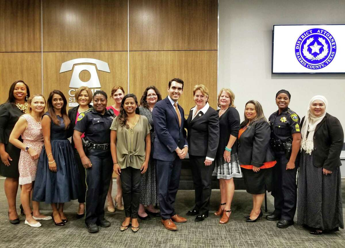 Harris County District Attorney Kim Ogg (center) accompanied by representatives of several local organizations launching a partnership to provide legal services to victims of domestic violence,dating violence, stalking, and sexual assault. (8/9/2018)