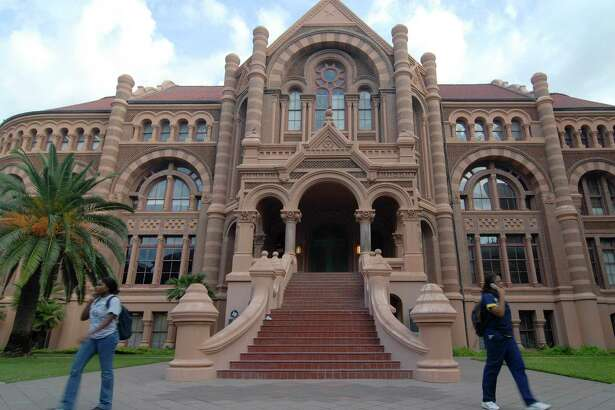 Students exit out of the Ashbel Smith Building also known as Old Red at the University of Texas Medical Branch in Galveston. In 2008, the Ashbel Smith building was flooded with six feet of water by Hurricane Ike.