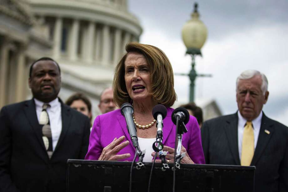 Democratic candidates are being pressed about whether they support House Minority Leader Nancy Pelosi, D-Calif., and are subjected to GOP attacks tying them to her regardless of how they answer. Above Pelosi speaks at a news conference in June. Photo: Bloomberg Photo By Al Drago / © 2018 Bloomberg Finance LP