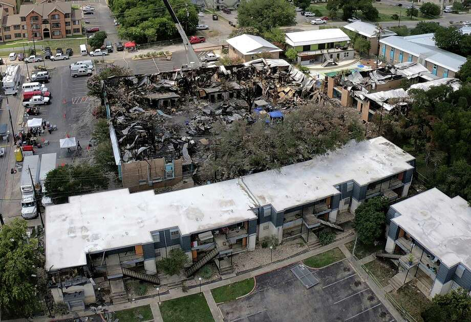 Five people died in a fire July 20 at Iconic Village Apartments in San Marcos. This aerial photo taken July 24 shows the collapsed roof of Building 500 and damage to an adjacent building at Vintage Pads in the foreground. Photo: Billy Calzada /Staff Photographer / San Antonio Express-News