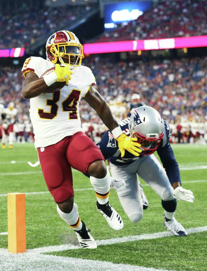 FOXBOROUGH, MA - AUGUST 9 : Byron Marshall #34 of the Washington Redskins runs in for a touchdown past Duron Harmon #21 of the New England Patriots during the preseason game between the New England Patriots and the Washington Redskins at Gillette Stadium on August 9, 2018 in Foxborough, Massachusetts. (Photo by Maddie Meyer/Getty Images) Photo: Maddie Meyer / 2018 Getty Images