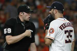 Houston Astros starting pitcher Justin Verlander (35) talks with home plate umpire Nic Lentz (59) after Lentz called a balk on him during the second inning of an MLB game at Minute Maid Park, Thursday, August 9, 2018, in Houston.