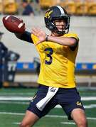 Quarterback Ross Bowers throws a pass during the first day of Cal Bears football practice at Memorial Stadium in Berkeley, Calif. on Friday, Aug. 3, 2018.