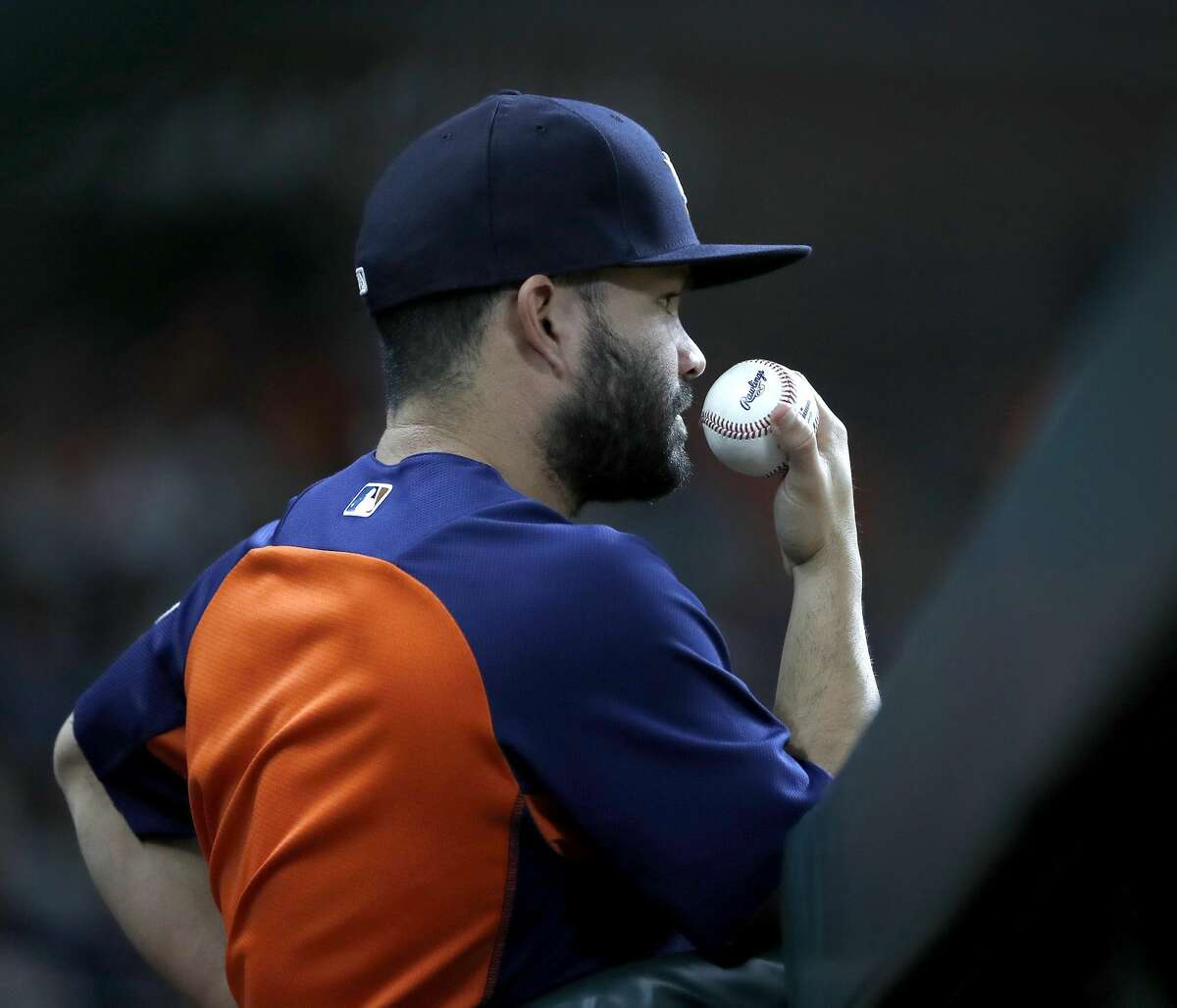 Houston Astros Jose Altuve (27) watches during the second inning of an MLB game at Minute Maid Park, Thursday, August 9, 2018, in Houston.