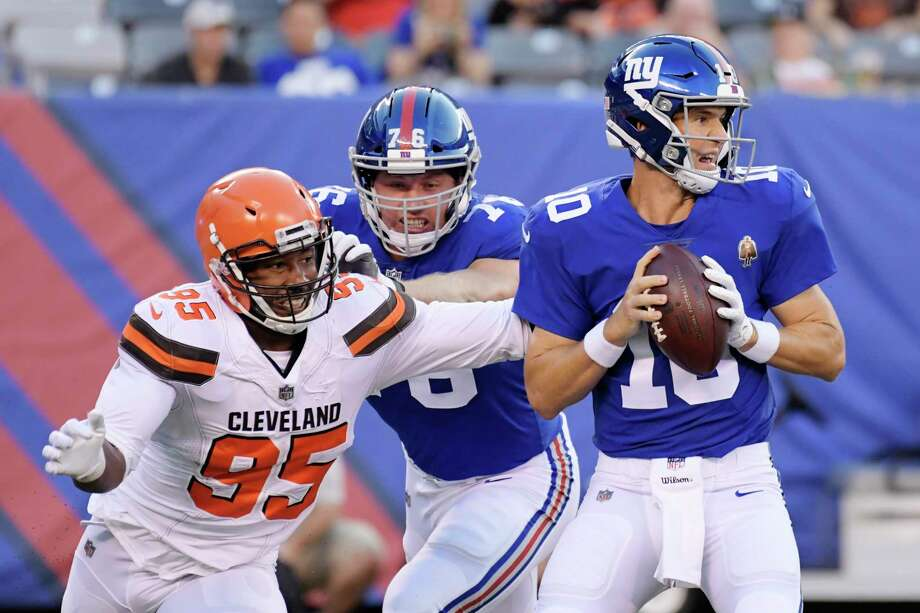 Cleveland Browns defensive end Myles Garrett (95) rushes New York Giants' Eli Manning (10) during the first half of a preseason NFL football game Thursday, Aug. 9, 2018, in East Rutherford, N.J. (AP Photo/Bill Kostroun) Photo: Bill Kostroun / FR51951 AP