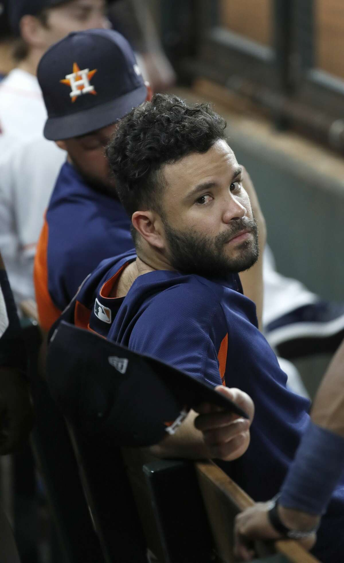 Houston Astros second baseman Jose Altuve in the dugout during the third inning of an MLB game at Minute Maid Park, Thursday, August 9, 2018, in Houston.