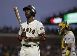 San Francisco Giants' Andrew McCutchen walks back to the dugout after striking out looking against Pittsburgh Pirates starting pitcher Ivan Nova in the fourth inning of a baseball game Thursday, Aug. 9, 2018, in San Francisco. (AP Photo/Eric Risberg)