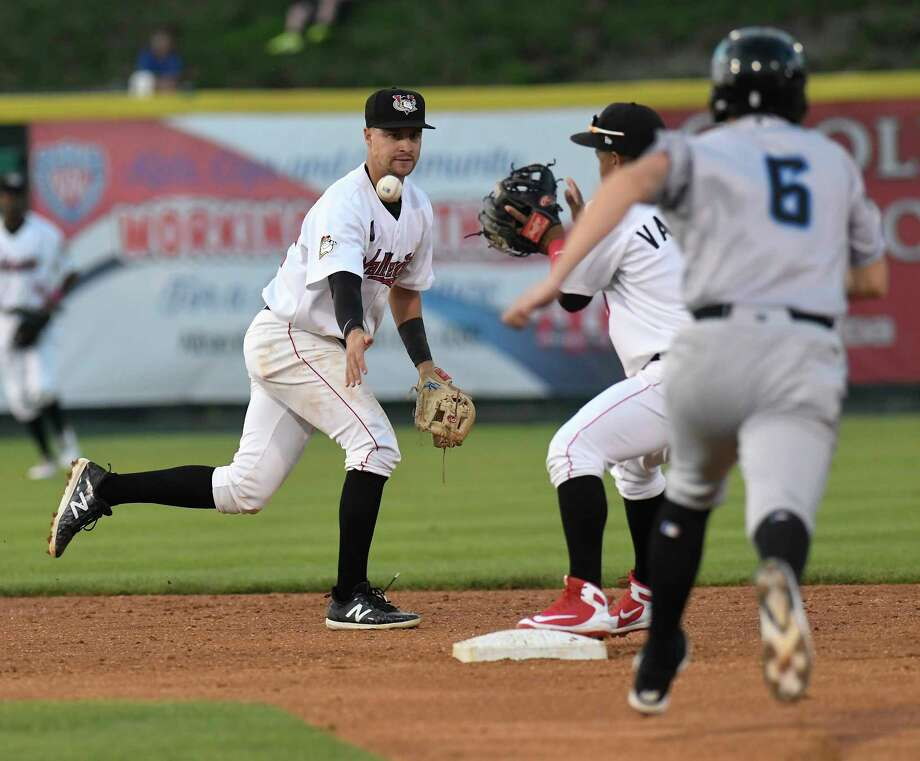 Tri-City ValleyCats shortstop Trey Dawson (32) tosses the ball to second baseman Enmanuel Valdez (9) making the first out against Hudson Valley Renegades Allen Smoot (6) on a double play during a minor league baseball game Thursday, Aug. 9, 2018, in Troy, N.Y. (Hans Pennink / Special to the Times Union) Photo: Hans Pennink / Hans Pennink