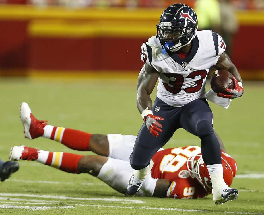 Houston Texans running back Troymaine Pope (33) breaks away from Kansas City Chiefs defensive tackle T.Y. McGill (99) during the third quarter of an NFL football game at Arrowhead Stadium on Thursday, Aug. 9, 2018, in Kansas City. Photo: Brett Coomer/Houston Chronicle