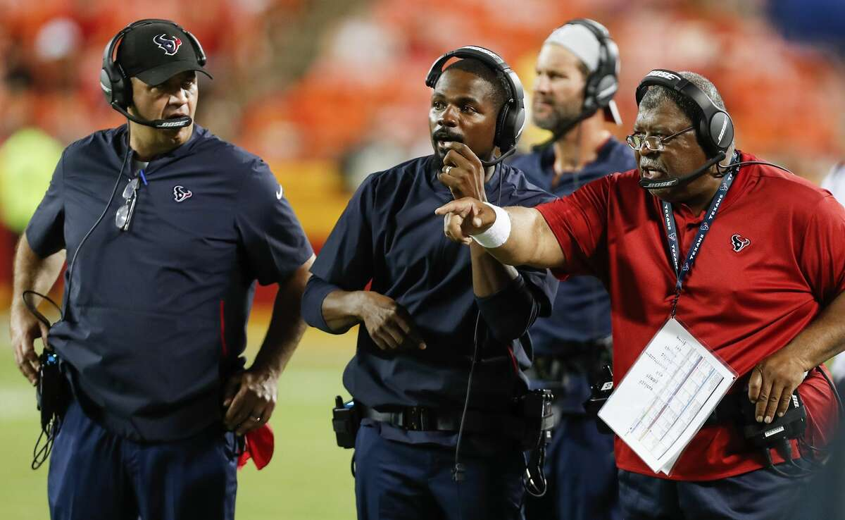 Houston Texans head coach Bill O'Brien and defensive coordinator Romeo Crennel call plays from the sidelines against the Kansas City Chiefs during the fourth quarter of an NFL football game at Arrowhead Stadium on Thursday, Aug. 9, 2018, in Kansas City.