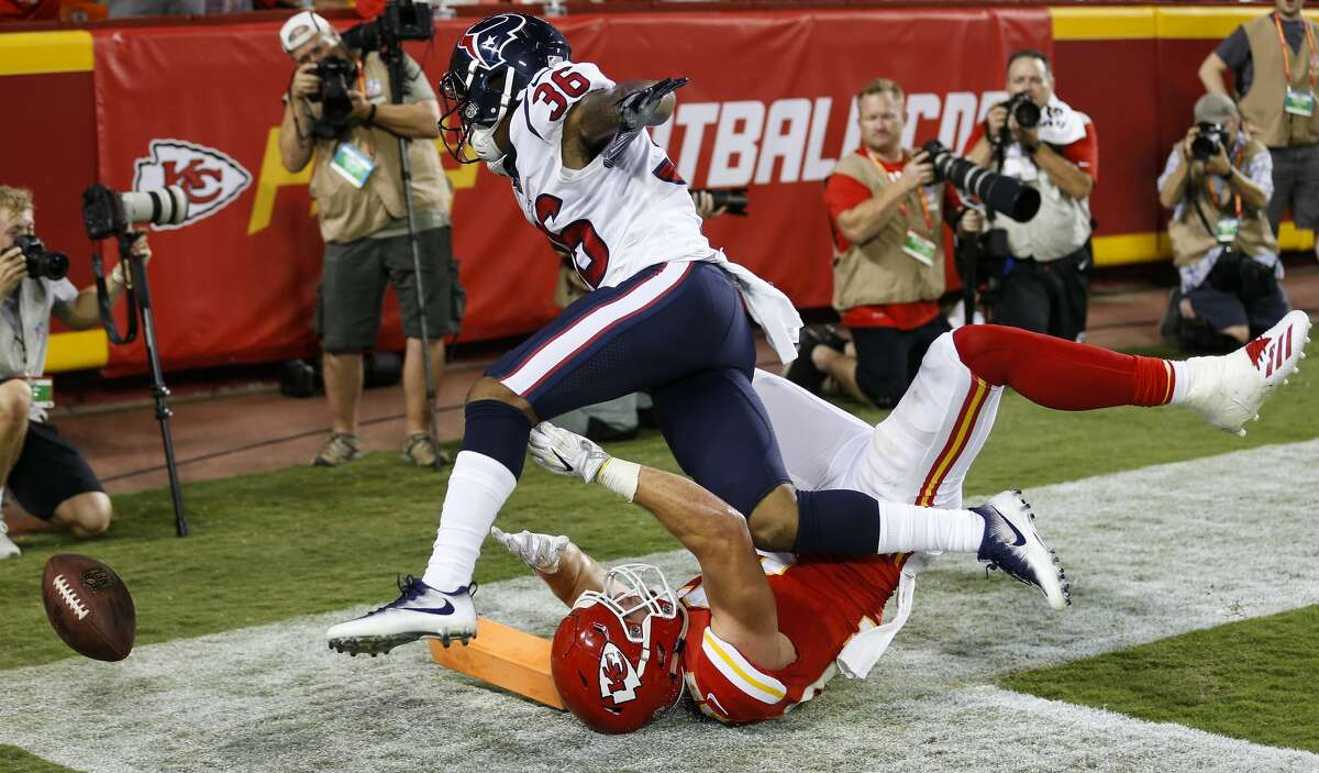 Houston Texans cornerback Josh Thornton (36) breaks up a pass on fourth down in the end zone intended for Kansas City Chiefs tight end Alex Ellis (82) during the fourth quarter of an NFL football game at Arrowhead Stadium on Thursday, Aug. 9, 2018, in Kansas City.