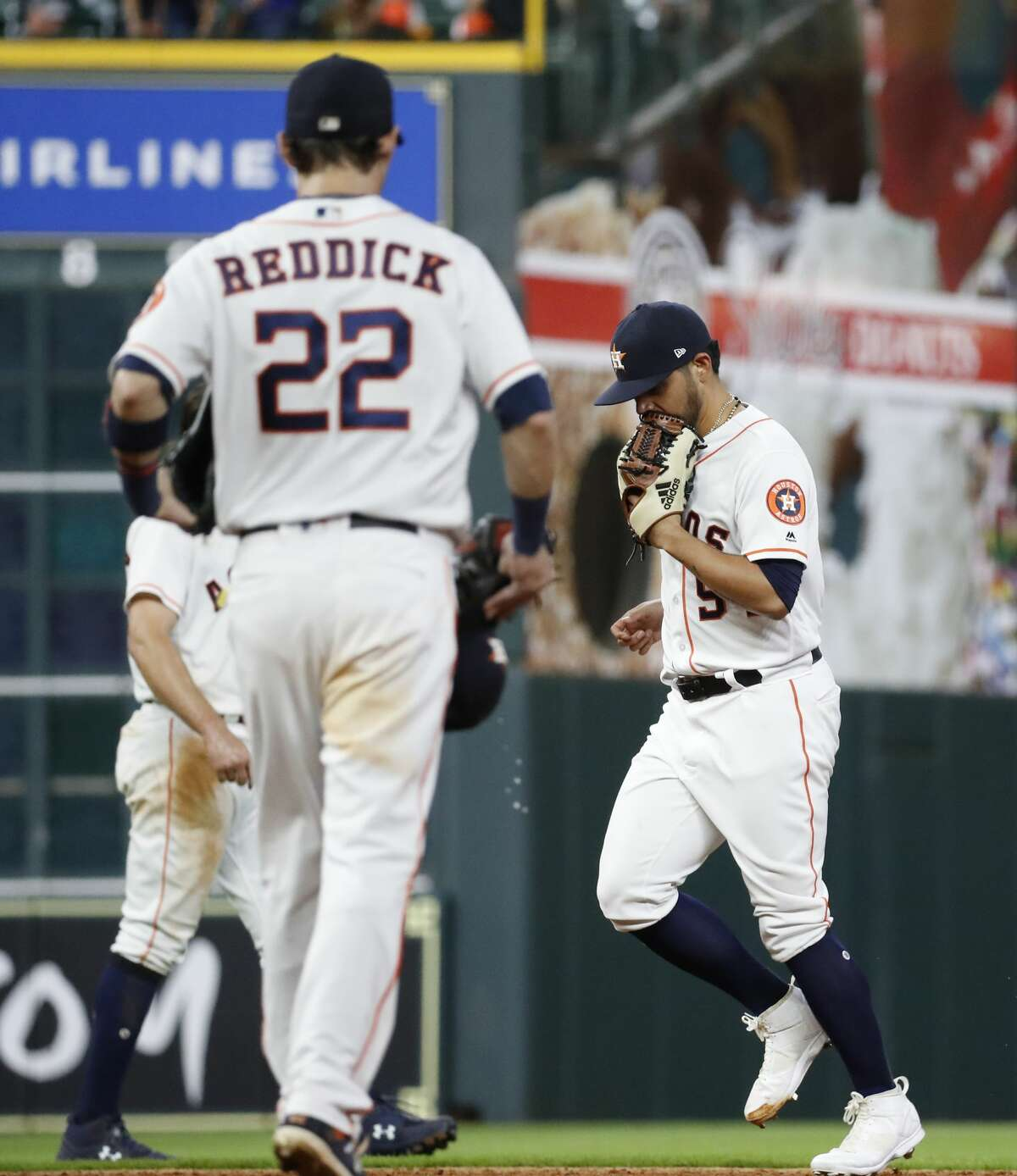 Houston Astros relief pitcher Roberto Osuna (54) runs out to the mound during the ninth inning of an MLB game at Minute Maid Park, Thursday, August 9, 2018, in Houston.