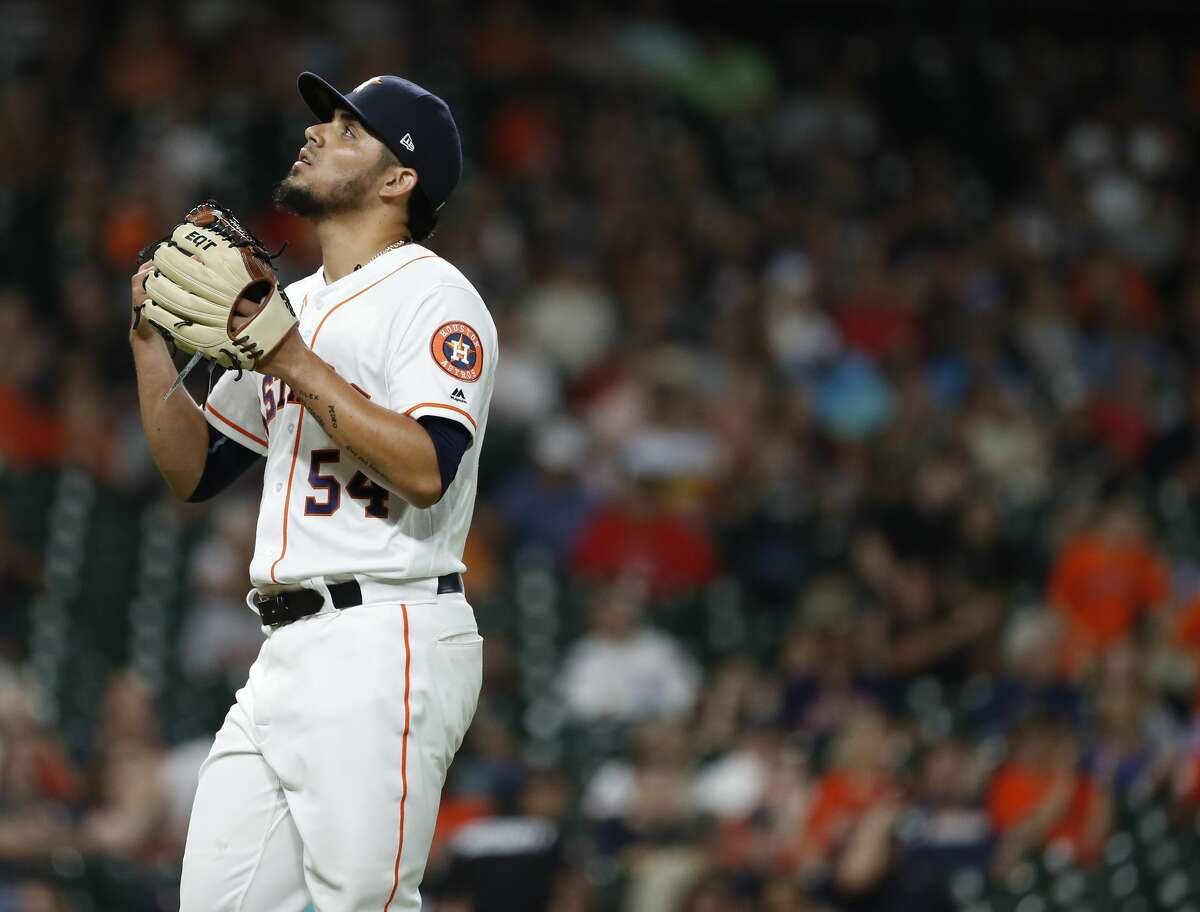 Houston Astros relief pitcher Roberto Osuna (54) reacts after the ninth inning of an MLB game at Minute Maid Park, Thursday, August 9, 2018, in Houston.