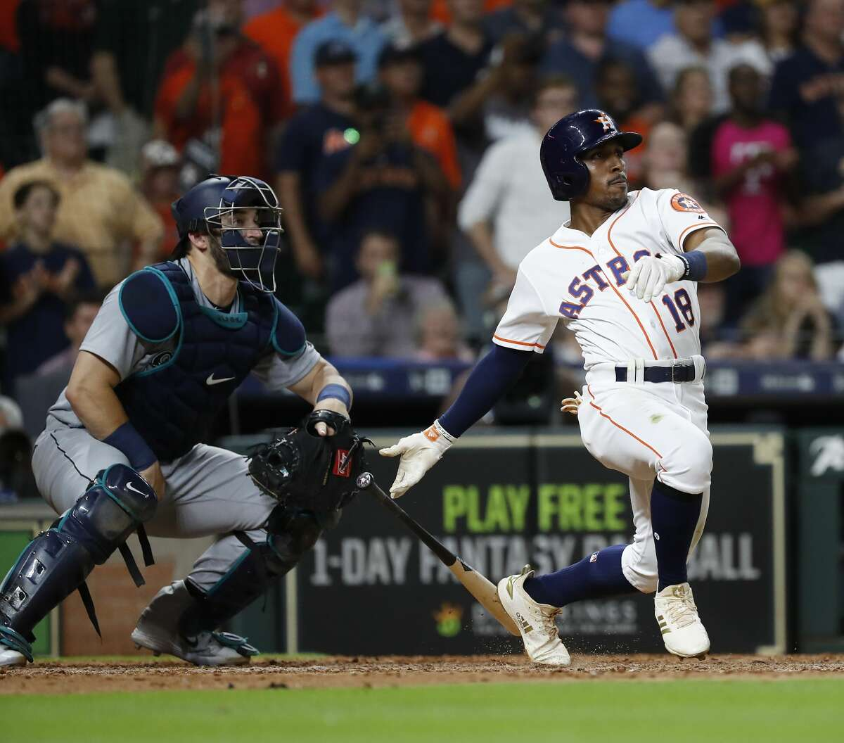 Houston Astros Tony Kemp (18) hits an RBI single during the sixth inning of an MLB game at Minute Maid Park, Thursday, August 9, 2018, in Houston.