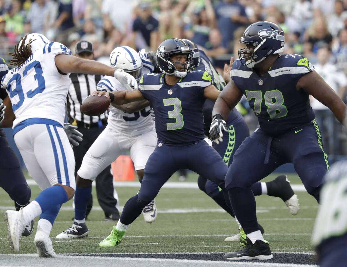2. D.J. FLUKER MAY BE THE ANSWER ON THE O-LINE The offensive line has been one of the Seahawks' biggest concerns in training camp. The team didn't make any significant changes during the offseason. But the acquisition of D.J. Fluker looks like it may have slid under the radar. The right guard, who signed a one-year deal with Seattle in March, had a strong performance Thursday in run blocking. His efforts created wide-open lanes for tailback Chris Carson in the first quarter, who finished with 26 yards on four rushes (Including a 12-yard pick up late in the opening period). Outside of health for the tailbacks, Fluker's efforts or going to be critical to Seattle establishing an effective run game for the first time in years.