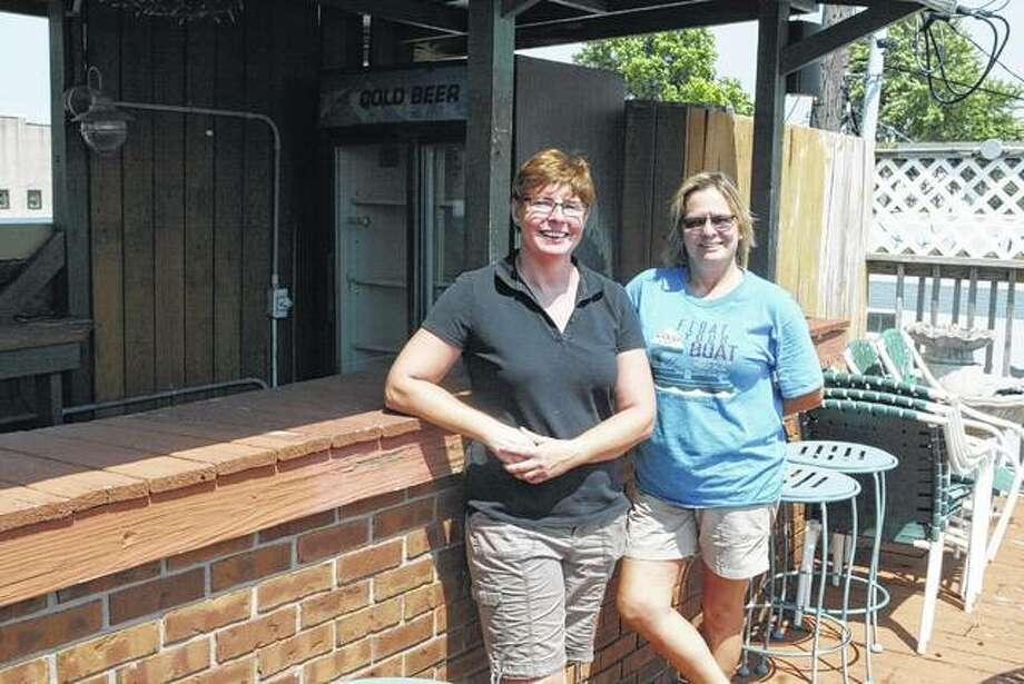 Jamie Cox (left) and Teri Hayes are transforming the former Irish Toad pub in downtown Jacksonville into The HandleBar Pizza & Pub, which they soon will open. Photo:     Greg Olson | Journal-Courier