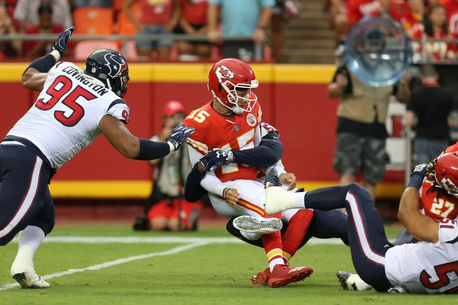 KANSAS CITY, MO - AUGUST 09: Kansas City Chiefs quarterback Patrick Mahomes (15) is pressured and brought to the ground by Houston Texans linebacker Duke Ejiofor (53) in the first quarter of an NFL preseason game between the Houston Texans and Kansas City Chiefs on August 9, 2018 at Arrowhead Stadium in Kansas City, MO.  (Photo by Scott Winters/Icon Sportswire via Getty Images) Photo: Icon Sportswire/Icon Sportswire Via Getty Images