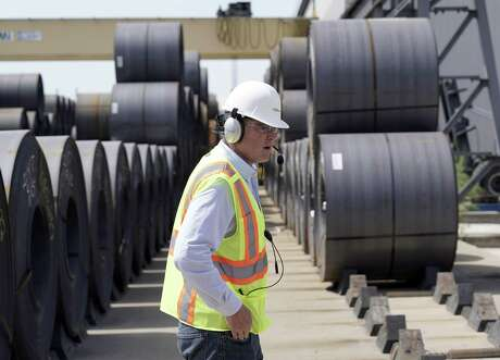 CEO Joel Johnson walks past rolls of steel at the Borusan Mannesmann Pipe manufacturing facility Tuesday, June 5, 2018, in Baytown, Texas. Borusan is seeking a waiver from the steel tariff to import 135,000 metric tons of steel tubing and casing annually over the next two years. (AP Photo/David J. Phillip)