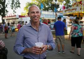 """Michael Avenatti, the lawyer representing adult film actress Stormy Daniels, drinks a beer at the Iowa State Fair in Des Moines, Iowa, Thursday, Aug. 9, 2018. Avenatti�s crusade for the porn actress taking on President Donald Trump has already catapulted him to cable news stardom and endeared him to many frustrated liberals. Now the self-styled """"dragon slayer"""" is taking his message to Iowa Democrats. (Zach Boyden-Holme/The Des Moines Register via AP)"""