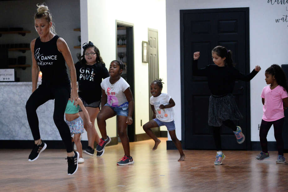 Kelsey Tanner teaches a hip-hop dance class for 5- to 8-year-olds on Aug. 2. The studio's grand opening is 8 p.m. today. Photo: James Durbin/Reporter-Telegram / ? 2018 Midland Reporter-Telegram. All Rights Reserved.