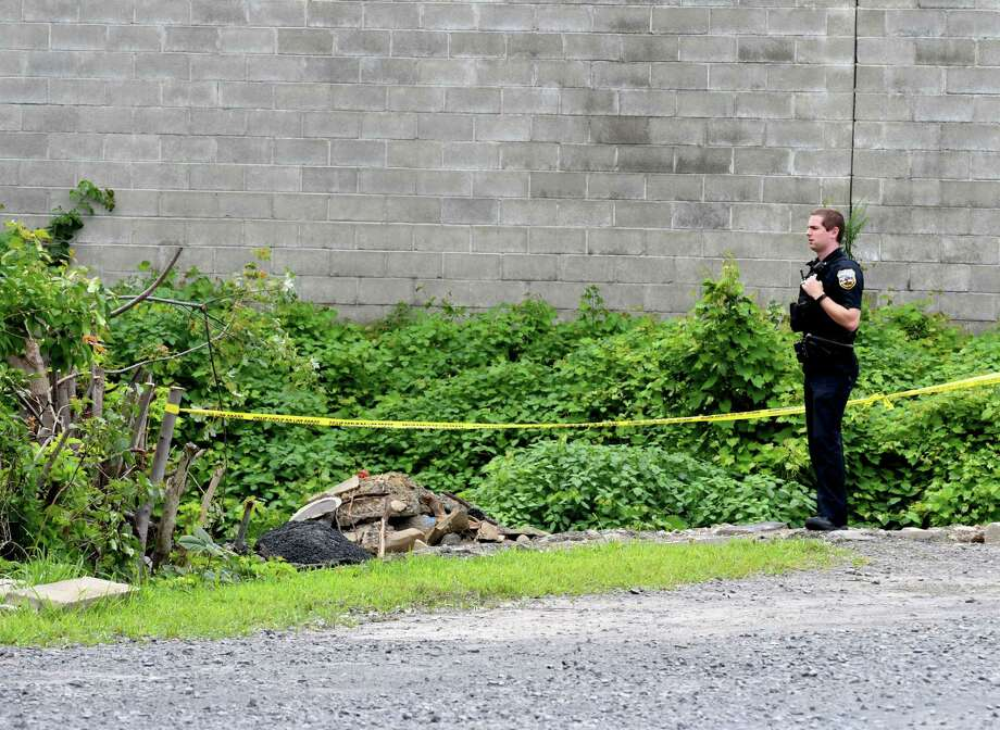 Police secure the scene in the backyard of 766 State St. on Friday, Aug. 10, 2018, in Schenectady, N.Y. A child's body was found behind the building when police searched the property on Thursday evening. (Will Waldron/Times Union) Photo: Will Waldron, Albany Times Union / 20044535A