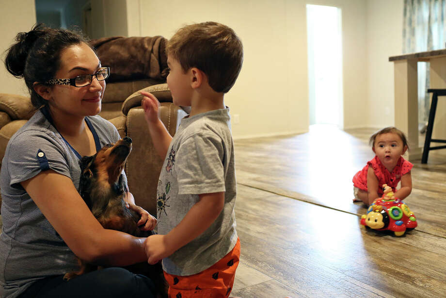 Danielle Kelley plays with their children, Michael, 3, and Raeleigh, 1, at her home in Cibolo on July 10, 2018. (Lisa Krantz | San Antonio Express-News)  / San Antonio Express-News