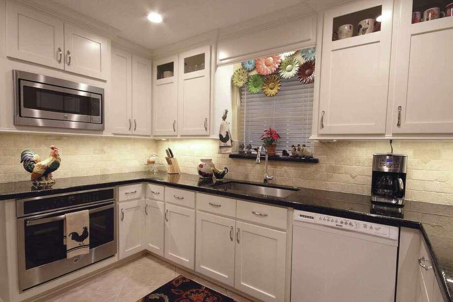 This remodeled kitchen maximizes storage.