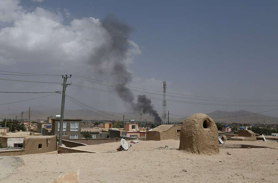 Smoke rising into the air after Taliban militants launched an attack on the Afghan provincial capital of Ghazni on August 10, 2018. - US forces launched airstrikes on August 10 to counter a major Taliban assault on an Afghan provincial capital, where terrified residents cowered in their homes amid explosions and gunfire as security forces fought to beat the insurgents back. (Photo by ZAKERIA HASHIMI / AFP)ZAKERIA HASHIMI/AFP/Getty Images Photo: ZAKERIA HASHIMI, AFP/Getty Images