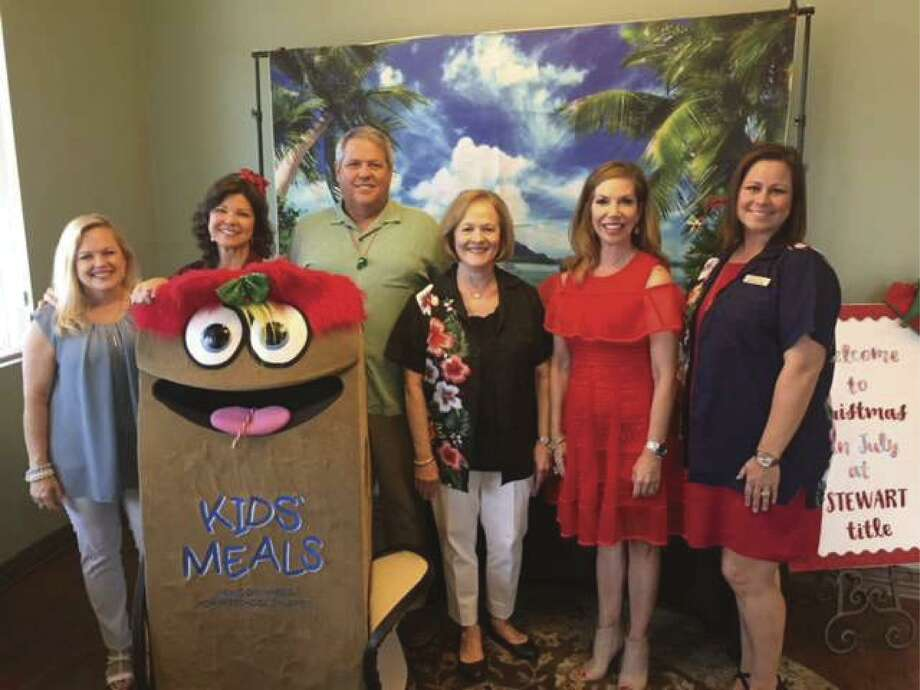 At the Cypress office's event, KidsMeals' executive director Beth Harp, left, is joined by Stewart Title executives (continuing from left) business development officer Tammy Barna; senior division president Larry Warren; branch manager/escrow officer Sharon Bristow; sales manager Roseann Rogers; and senior business development officer Joellen Newton.