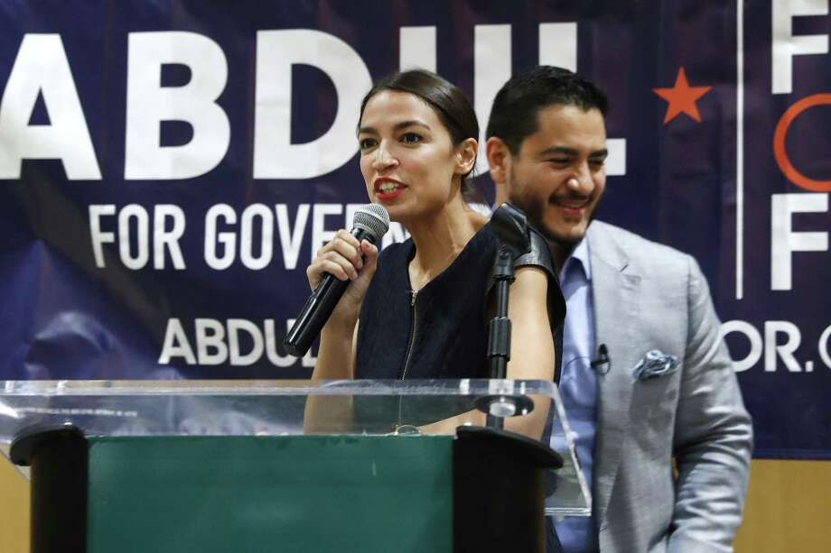 Alexandria Ocasio-Cortez, a Democratic congressional candidate from New York, speaks during a July campaign stop for Michigan for Democratic gubernatorial candidate Abdul El-Sayed, right, in Detroit. Photo: Paul Sancya / Associated Press / Copyright 2018 The Associated Press. All rights reserved