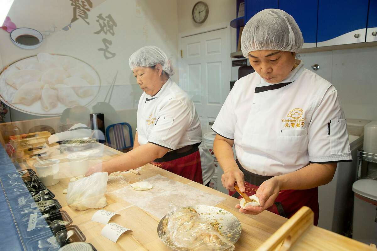 From left: Ms. Zhen and Ms. Zheng make dumplings at Yuanbao Jiaozi, Saturday, Aug. 4, 2018, in San Francisco, Calif. The Chinese restaurant is located at 2110 Irving St.