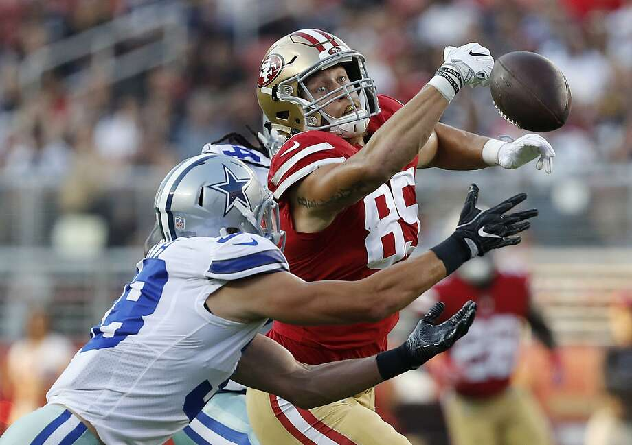 San Francisco 49ers tight end George Kittle (85) cannot catch a pass between Dallas Cowboys defensive back Jeff Heath, foreground, and linebacker Jaylon Smith, rear, during the first half of an NFL preseason football game in Santa Clara, Calif., Thursday, Aug. 9, 2018. (AP Photo/Josie Lepe) Photo: Josie Lepe / Associated Press