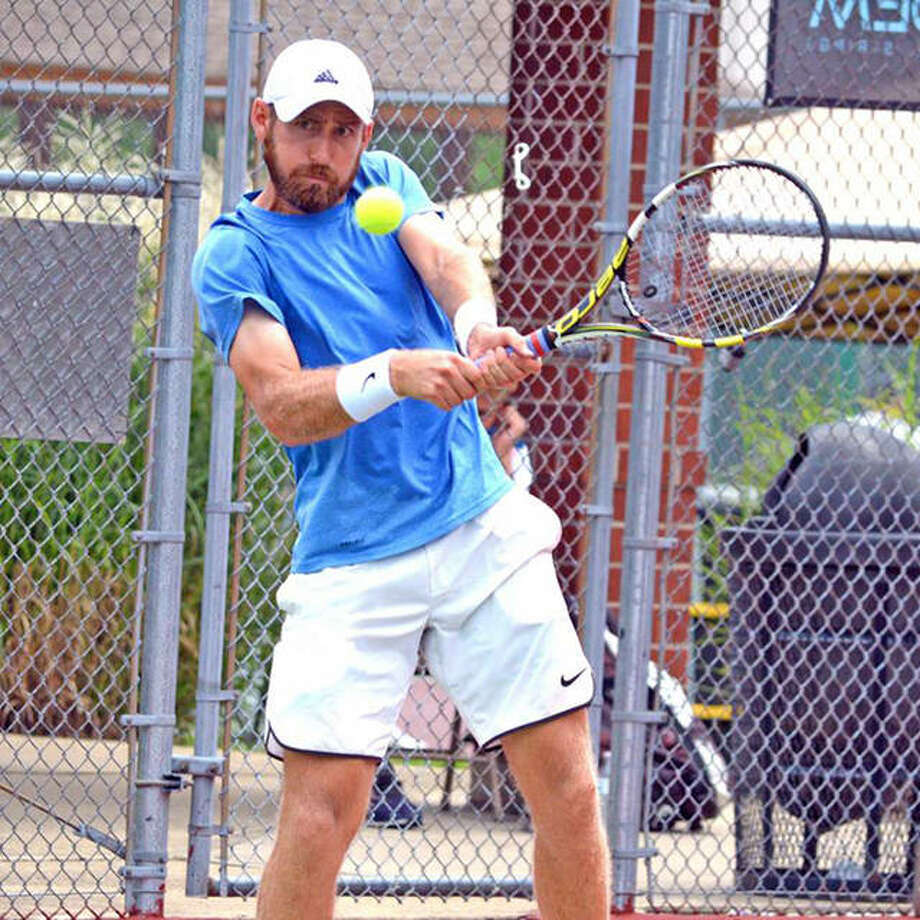 Nicholas Meister makes a backhand return during his doubles semifinal at the USTA Edwardsville Futures on Thursday at Edwardsville High School. Photo:       Scott Marion / Hearst Newspapers