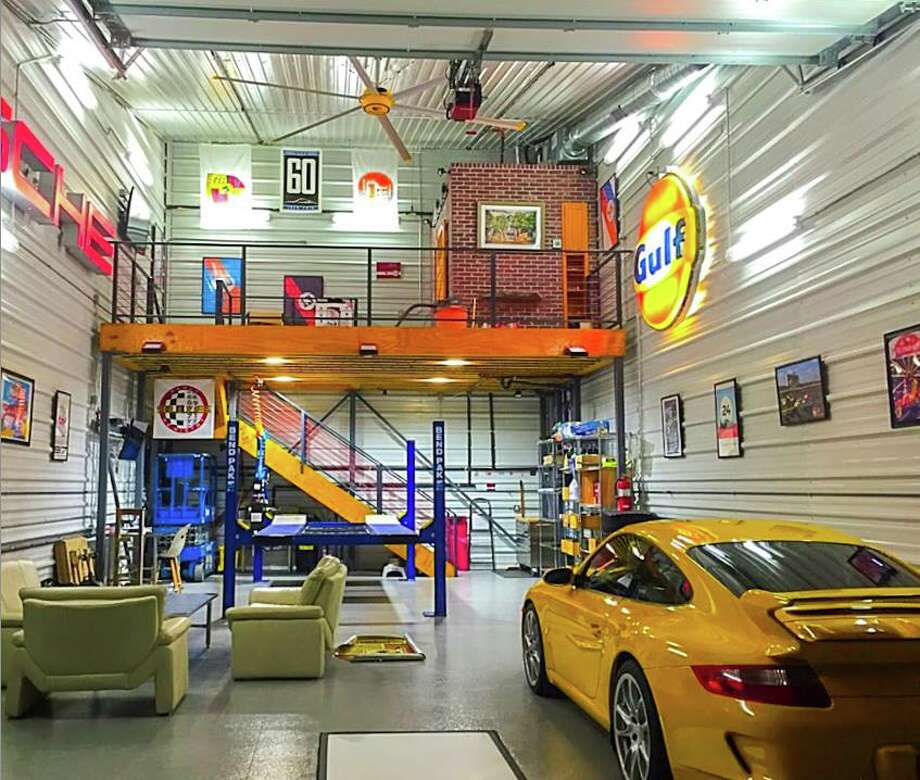 This is the inside of a completed Garages of Texas space in the Dallas area. The garage condo community for car enthusiasts will soon have a location in the Katy area. Photo: Garages Of Texas