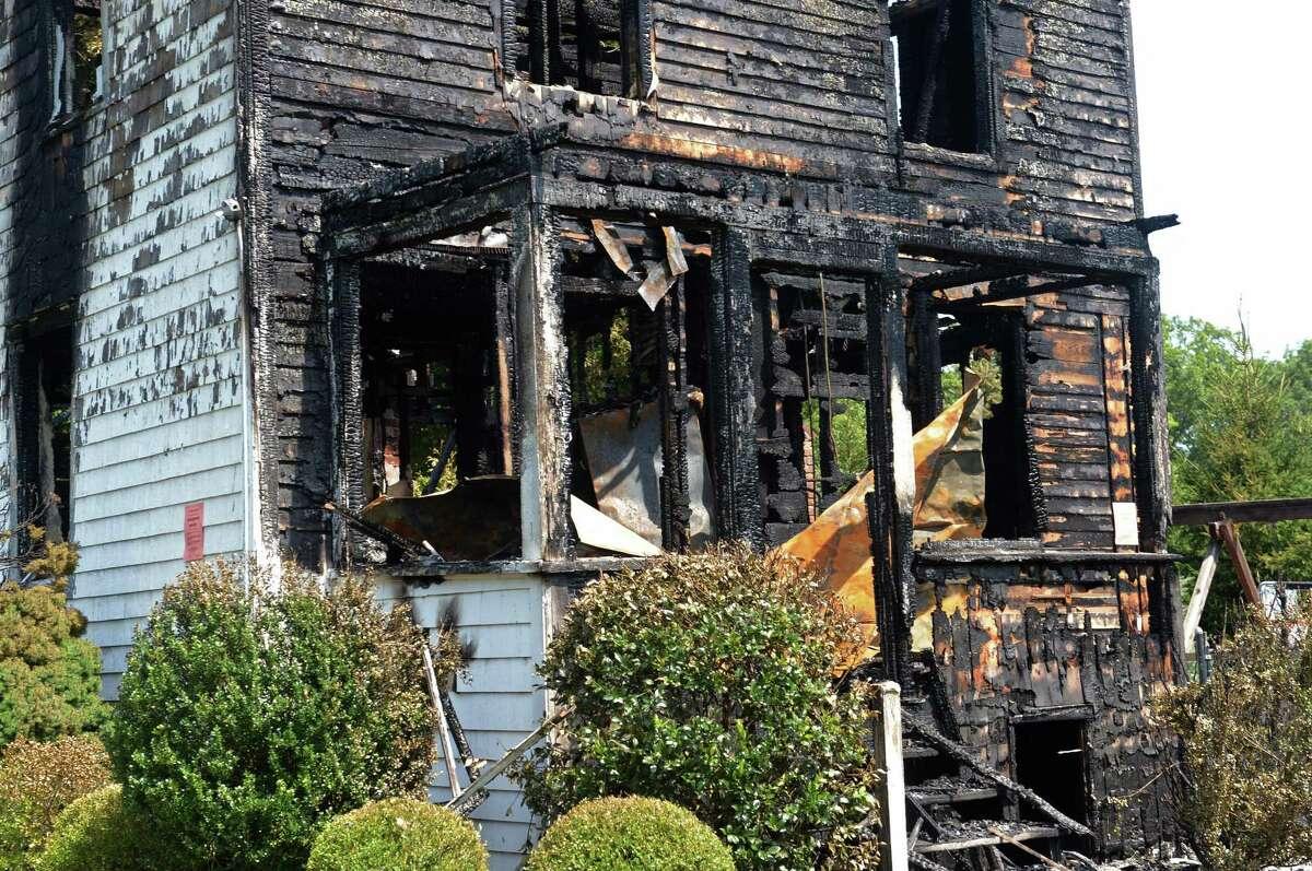 The Locust Road home that collapsed early Friday morning, August 10, 2018, after a fire broke out overnight in Greenwich, Conn. The Greenwich Fire Department responded to a fire at 15 Locust Road around midnight and said the two-and-a-half story home was completely aflame by the time units arrived.